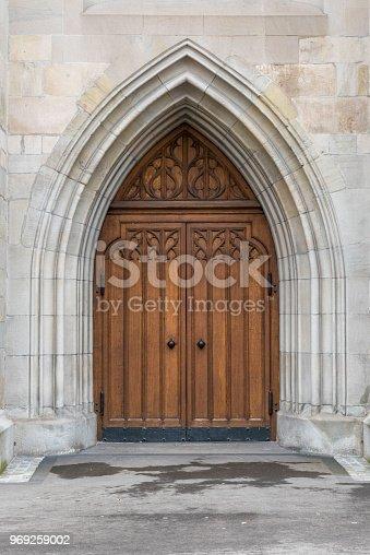 Wooden arched door of church in Zurich, Switzerland