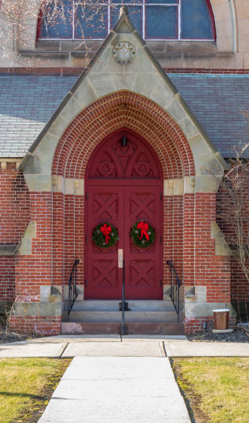 Church doors with Christmas wreaths stock photo