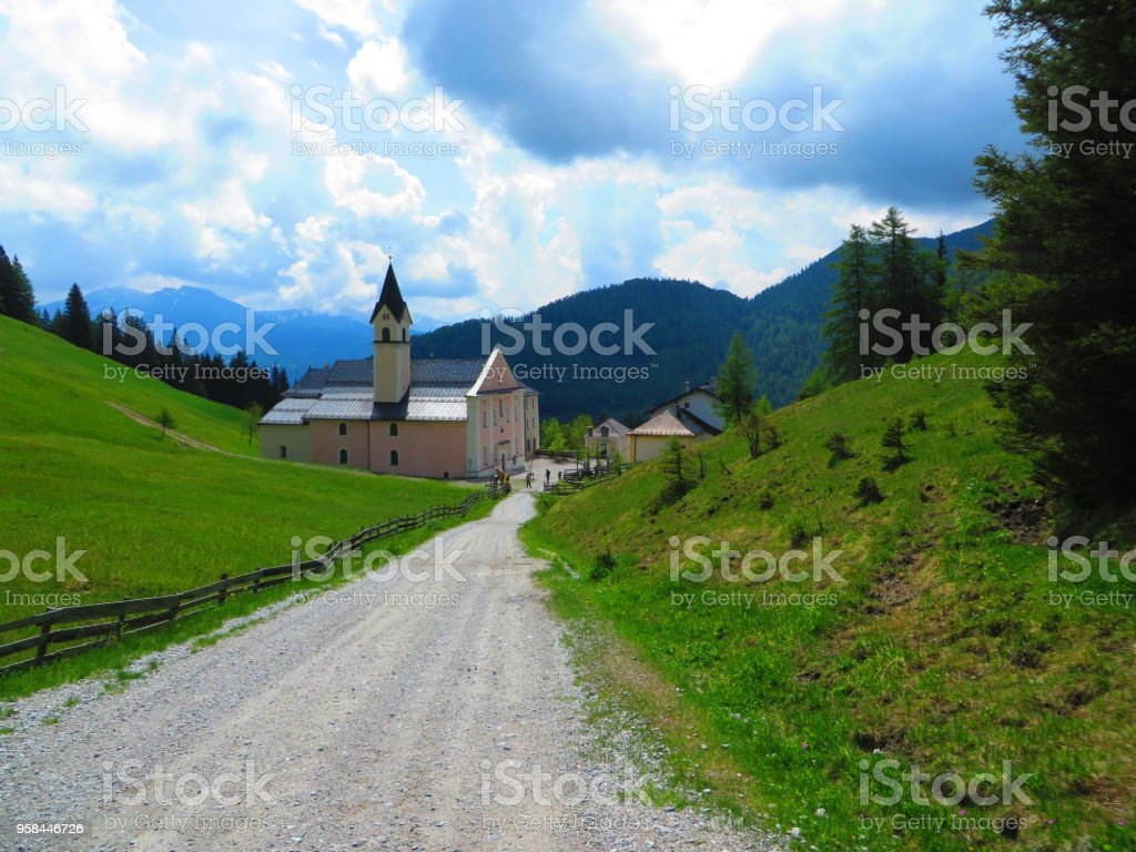 A Church down a long road upon a hill stock photo