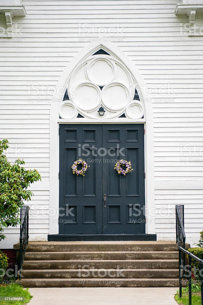 The tall entrance doorway in to a church in the New England region of...