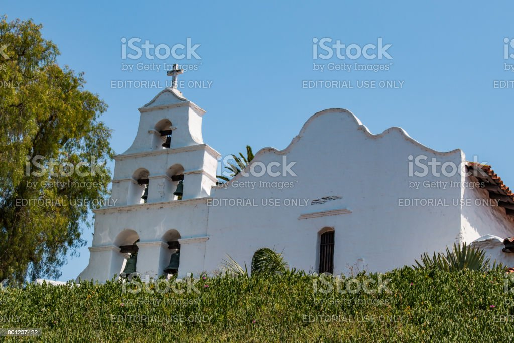 Church Facade and Bell Tower at Mission San Diego stock photo