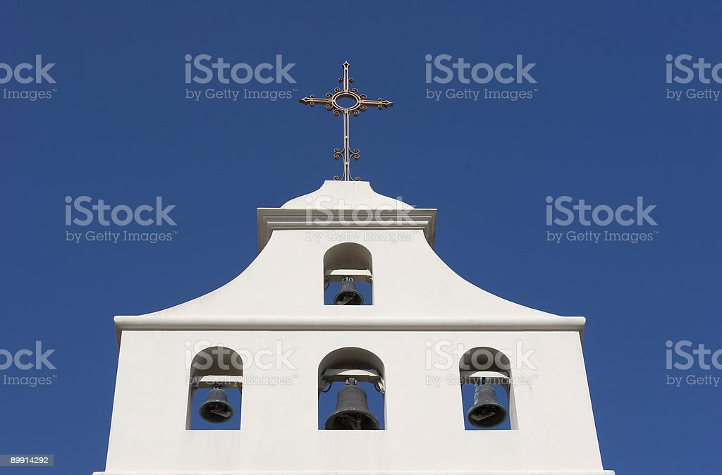 Church Facade with Bells and Cross royalty-free stock photo