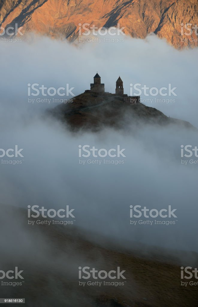 Church floating in clouds stock photo