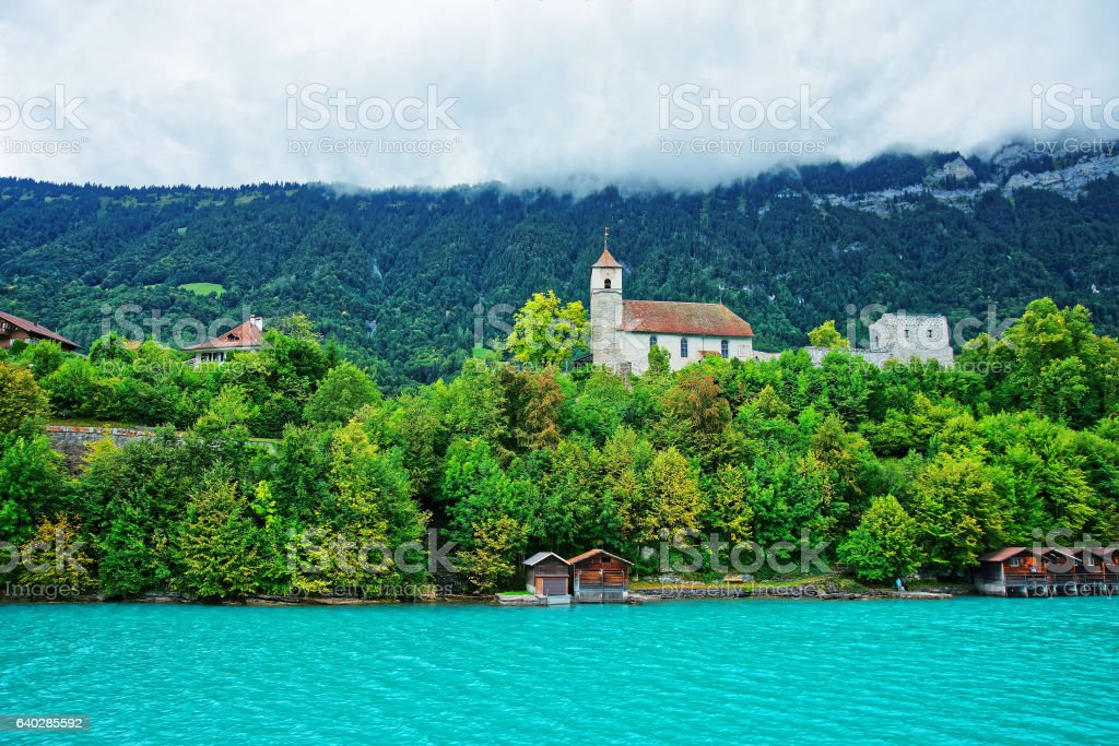 Church in Lake Brienz and Brienzer Rothorn mountain Bern Switzerland stock photo