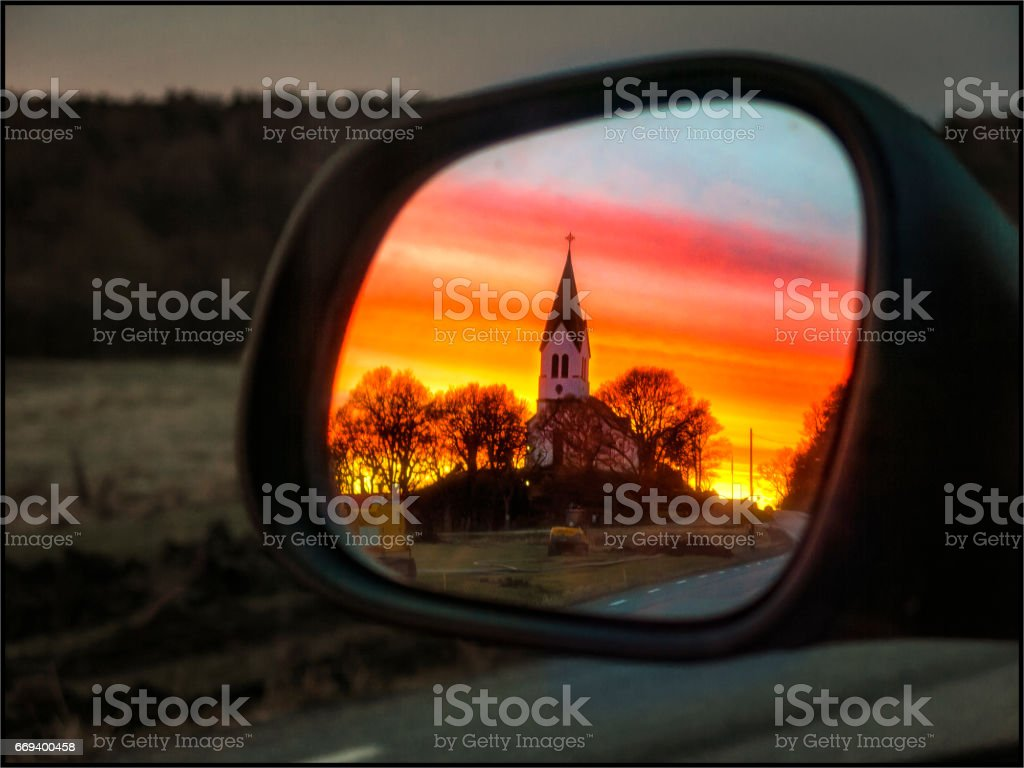 Church in rearview mirror stock photo