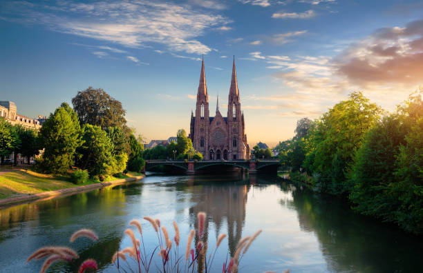 Church in Strasbourg Reformed Church of St. Paul in Strasbourg at sunrise, France strasbourg stock pictures, royalty-free photos & images