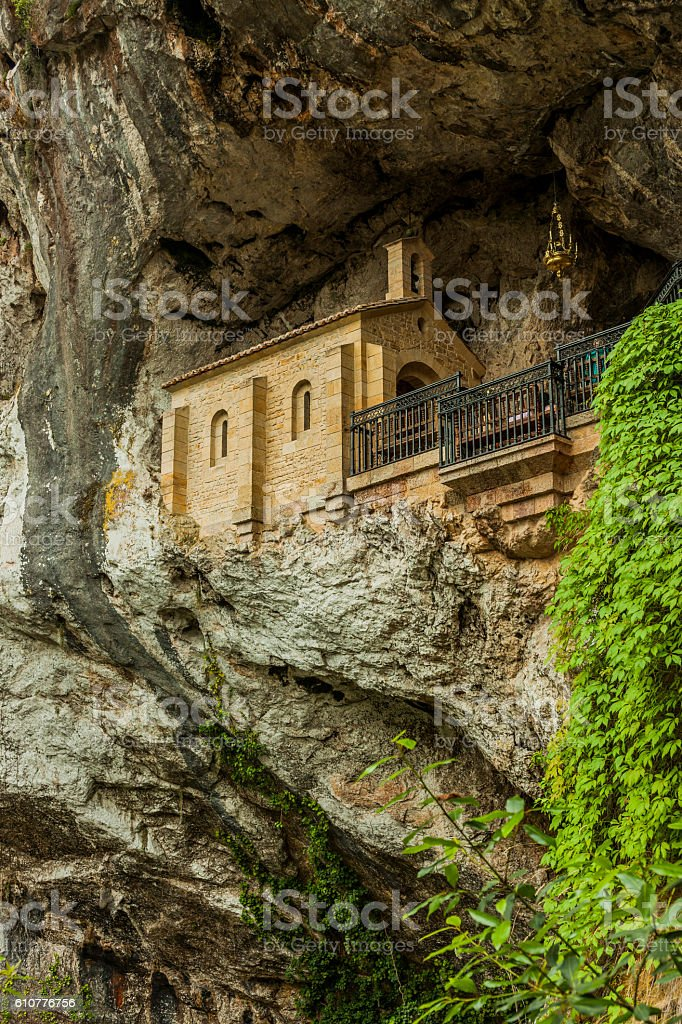 Church in the holy cave in the mountain in Covadonga stock photo