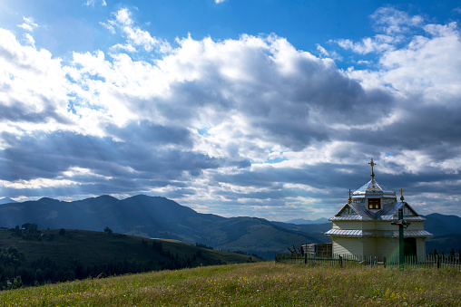 Church in the mountains under the blue sky