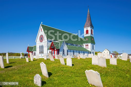 St Paul's Anglican Church and cemetery in Trinity, Newfoundland, Canada on a sunny day.