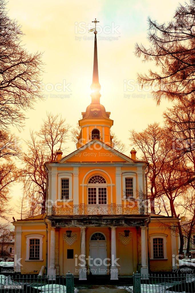Church in Tsarskoye Selo, Pushkin, Saint Petersburg Russia. Sunset with a bright amber sky and sun halo. Toned stock photo