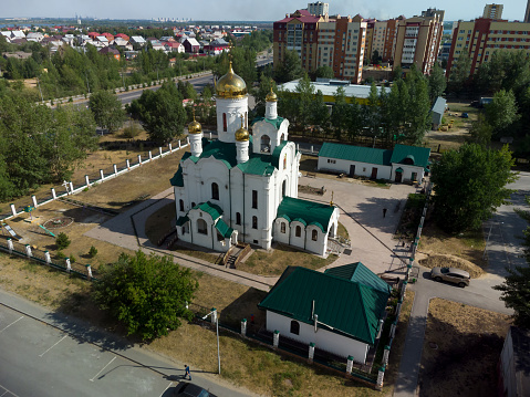 Tyumen, Russia - June 17, 2021: Aerial view onto temple in honor of the Reverend Seraphim of Sarov. Tura residential district