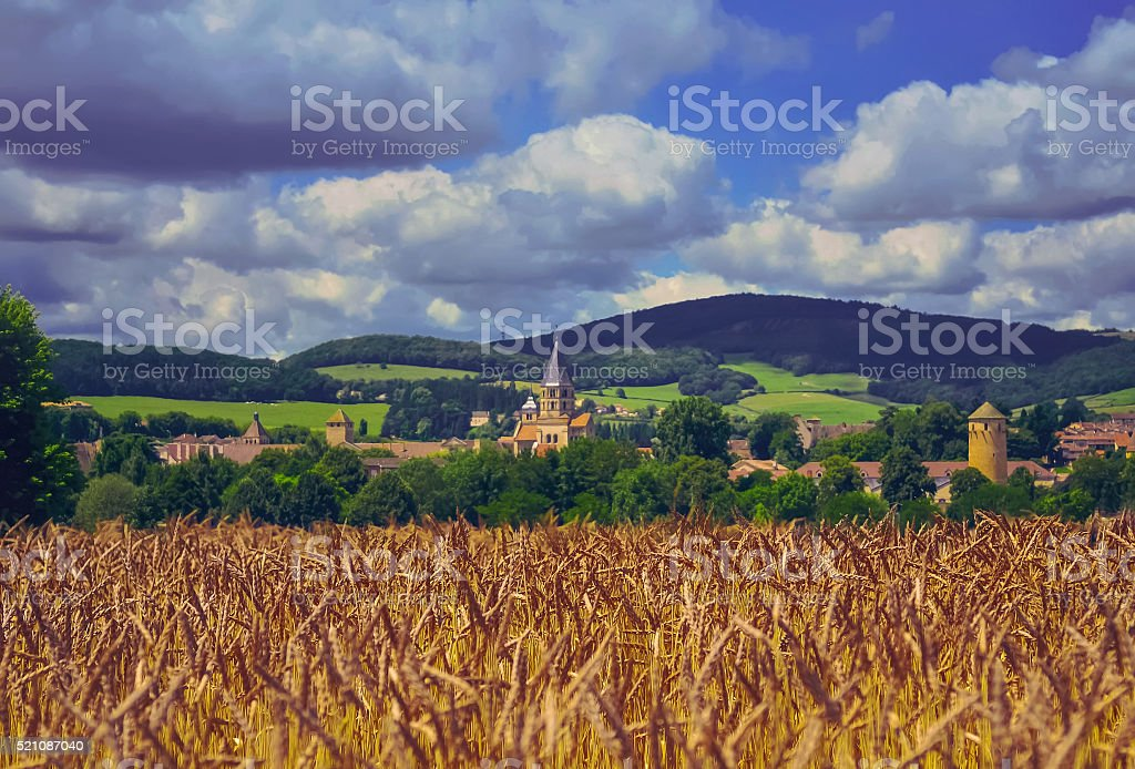 Church in wheat field in a village , Burgundy, France stock photo
