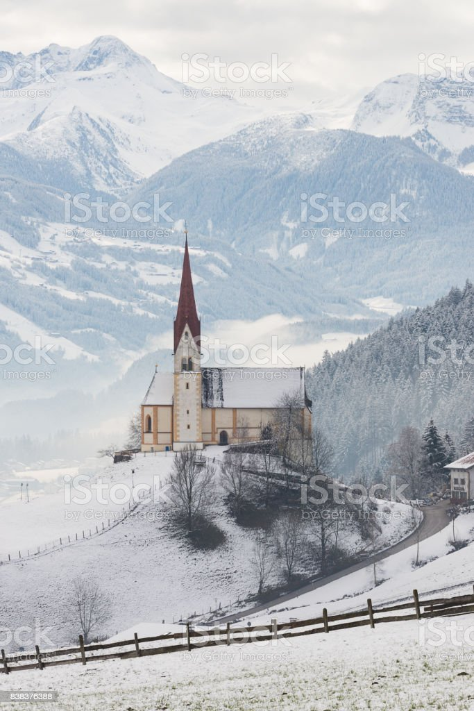 Church in Zillertal in winter in Austria stock photo