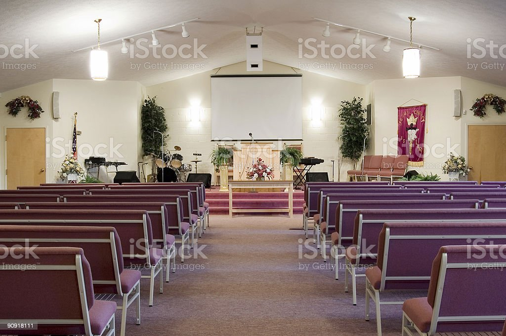 Church interior with pews and lights stock photo