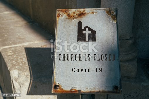Church is closed sign. Cancellation of church services because of coronavirus outbreak. Church and Religion affected by COVID-19. Stay home concept.