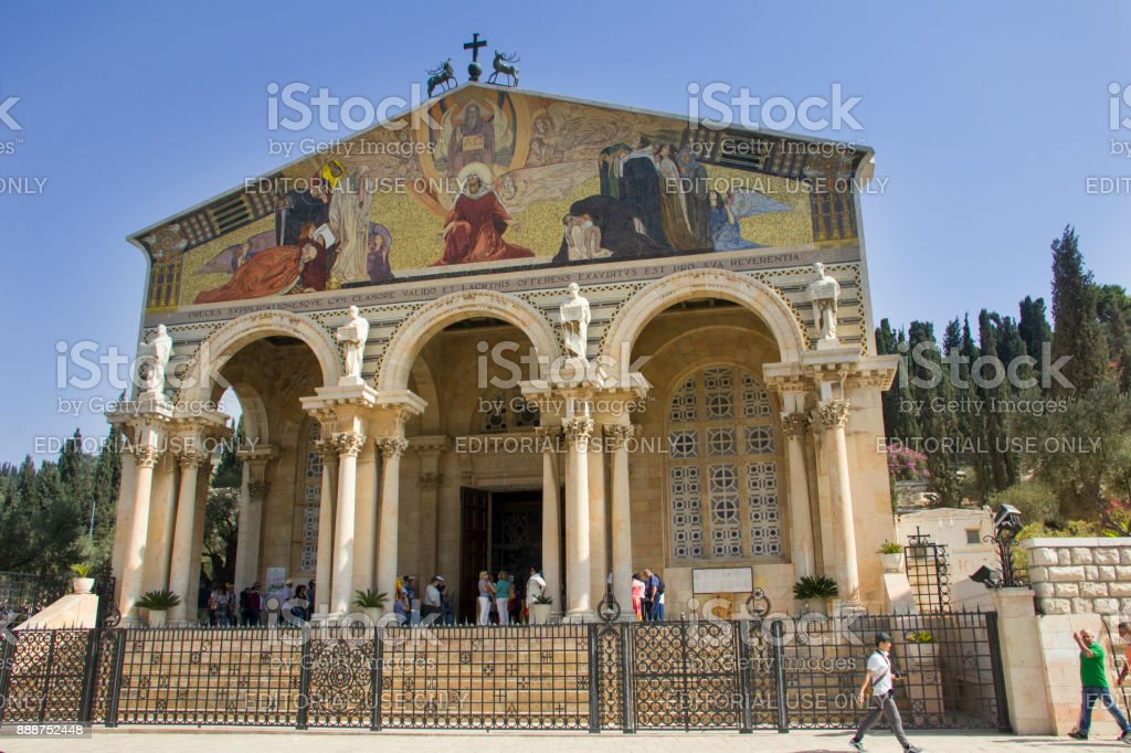 Church of All Nations in Jerusalem with pilgrims and tourists, view from the front. stock photo