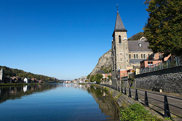 Church of Anseremme, Dinant Church of Anseremme, Dinant, Belgium at the Meuse river in the heart of the Belgian Ardennes. meuse river stock pictures, royalty-free photos & images