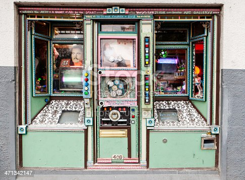 Portland, Oregon, USA - October 6, 2011: A color facade at 408 NW Couch Street in downtown Portland that holds the 24 Church of Elvis.  The display holds various knick knacks that are a tribute to Elvis and the time period of his life.