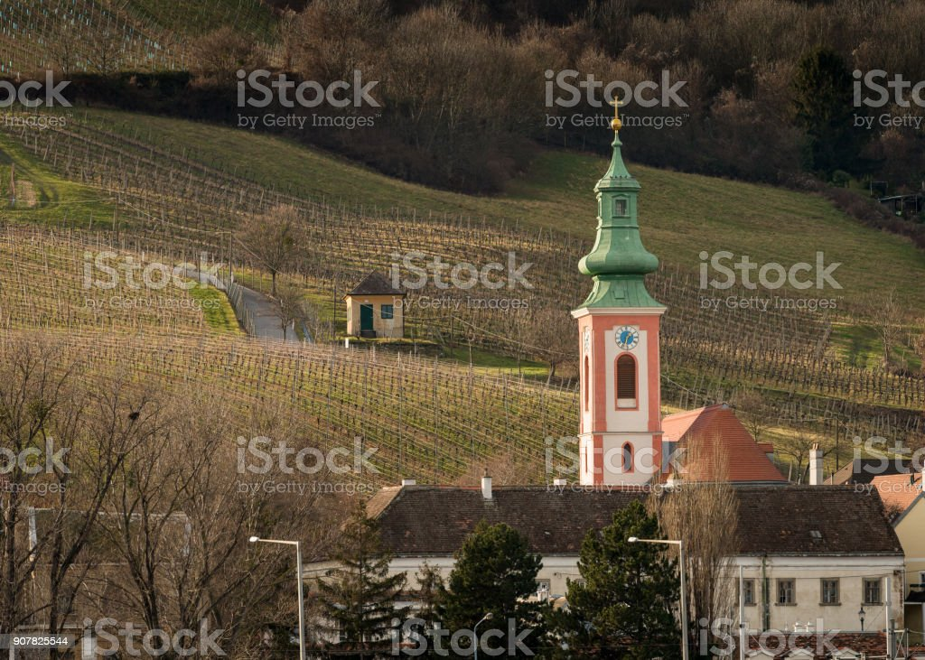 Church of Kahlenbergerdorf as seen from the Danube in winter stock photo