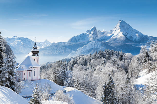 Church of Maria Gern with Watzmann in winter, Berchtesgadener Land, Bavaria, Germany Panoramic view of beautiful winter wonderland mountain scenery in the Alps with pilgrimage church of Maria Gern and famous Watzmann summit in the background, Berchtesgadener Land, Bavaria, Germany bavarian alps stock pictures, royalty-free photos & images