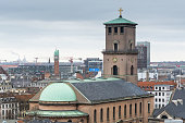 Church of Our Lady (Vor Frue Kirke), Aerial view of downtown of Copenhagen City from the The Round Tower (Rundetaarn) in rainy misty day with cloudy sky