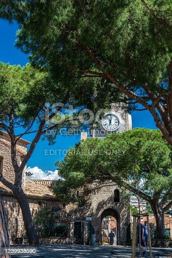 Cannes, France - June 12, 2019 : Hilltop Gothic-style stone church with bell tower completed in the 1600s, featuring a musical crèche and city views.