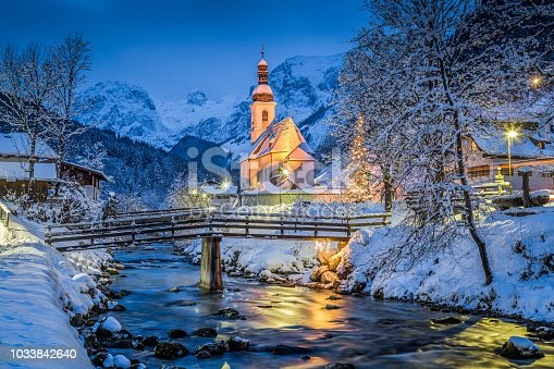 istock Church of Ramsau in winter twilight, Bavaria, Germany 1033842640