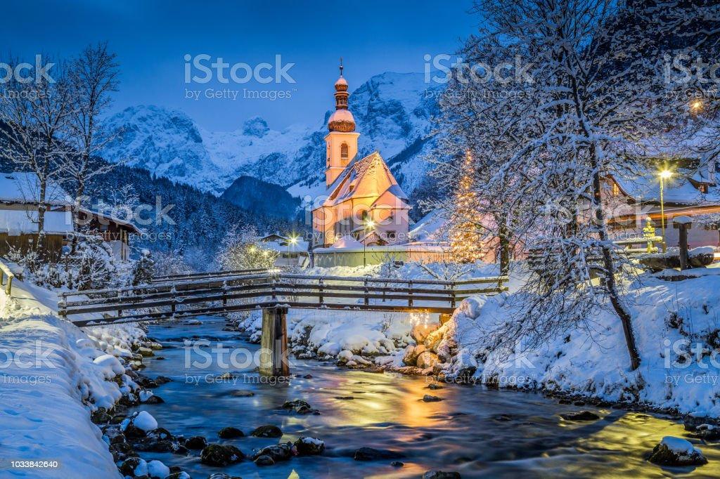 Church of Ramsau in winter twilight, Bavaria, Germany stock photo