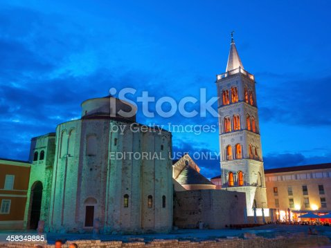 Zadar, Croatia - June 3, 2010: Church of Saint Donat, Zadar, Croatia lit up by night. On close inspection people can be seen near some cafes in the distance.