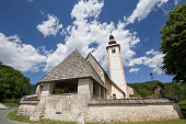 istock Church of Saint John the baptist, or cerkev svetega janeza krstnika, a medieval catholic church, one of the main landmarks of Ribcev Laz, Slovenia, by Lake Bohinj. 1330118553