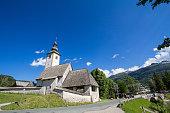 istock Church of Saint John the baptist, or cerkev svetega janeza krstnika, one of the main landmarks of Ribcev Laz, by Lake Bohinj. 1330121110