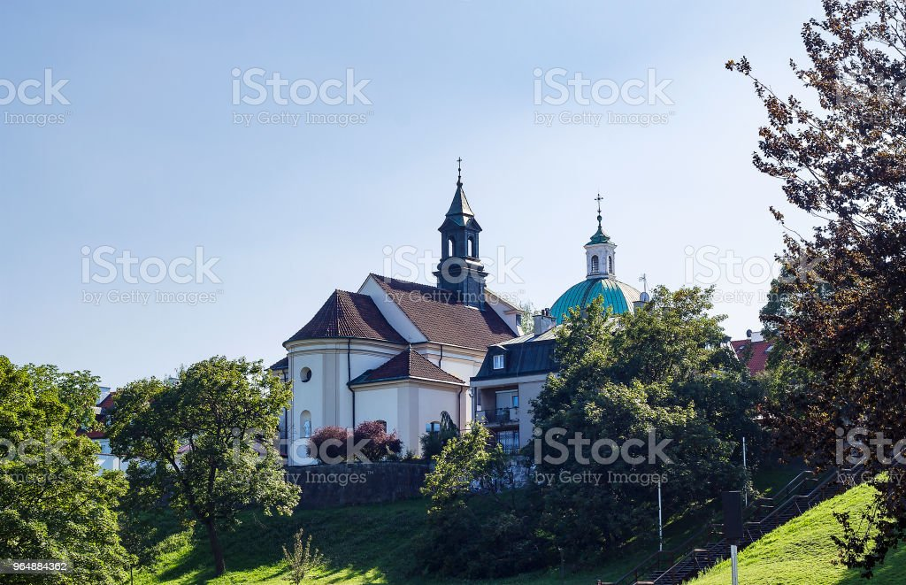 Church of St. Benon among trees in Warsaw, Poland royalty-free stock photo