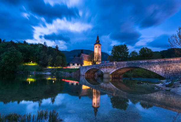 Church of St John the Baptist with bridge at sunset, Bohinj Valley and Lake, Triglav National Park, Upper Carniolan, Slovenia, Europe stock photo