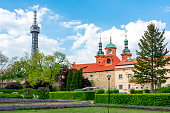 istock Church of St. Lawrence and Petrin lookout tower, Prague, Czech Republic 1180593841