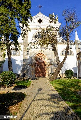 Tavira, Algarve / Faro district, Portugal: Saint Mary's church is Tavira's main Catholic temple, originally built in the 13th century by the Order of St James - seen from Jorge Correia garden - Igreja de Santa Maria do Castelo.