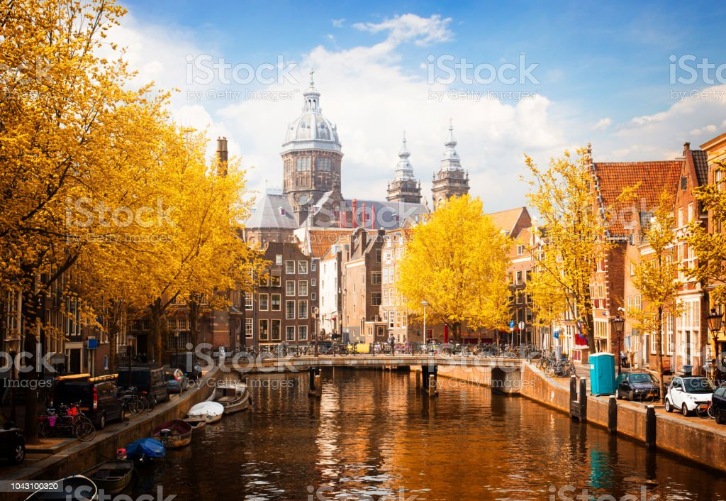 Church of St Nicholas , Amsterdam Church of St Nicholas, old town canal in Amsterdam at fall, Holland, toned Amsterdam Stock Photo