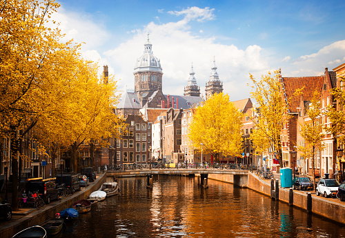 Church of St Nicholas, old town canal in Amsterdam at fall, Holland, toned