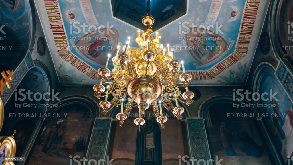 Church of St. Nicholas, large gold or bronze chandelier in the temple or cathedral, big bronze with handelier in the church, orthodox church inside stock photo
