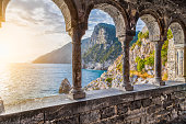 Columns of famous gothic Church of St. Peter (Chiesa di San Pietro) with beautiful shoreline scenery at sunset in the town of Porto Venere, Ligurian Coast, province of La Spezia, Italy.