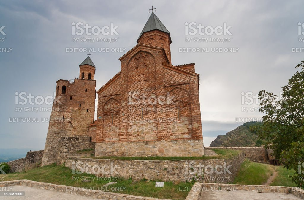 Church of the Archangels and Caucasus mountains in Kakheti, Georgia stock photo