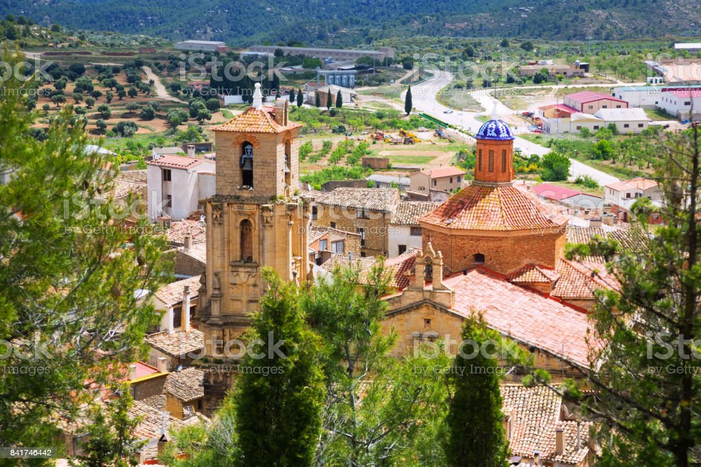 Church of the Assumption in  summer time. Calaceite stock photo