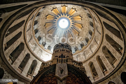 Rays of light inside the Church of the Holy Sepulchre. Jerusalem and is considered holy to the three major religions—Judaism, Christianity, and Islam.