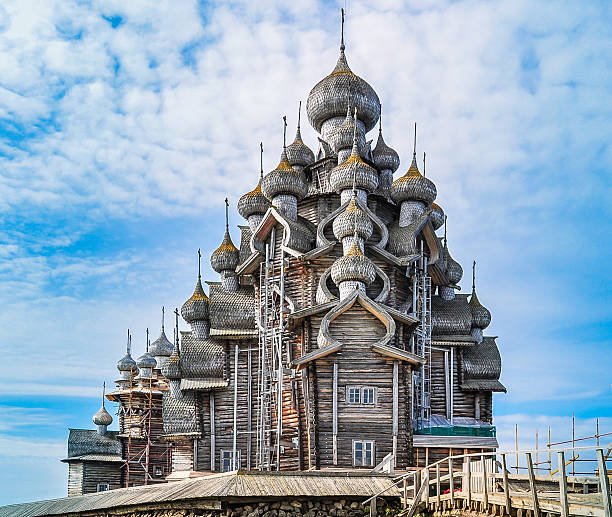 Church of the Transfiguration - Kizhi Island, Russia Built in the early 18th century, it is an octagonal spruce and pine log framework with 22 domes covered with birch bark. republic of karelia russia stock pictures, royalty-free photos & images