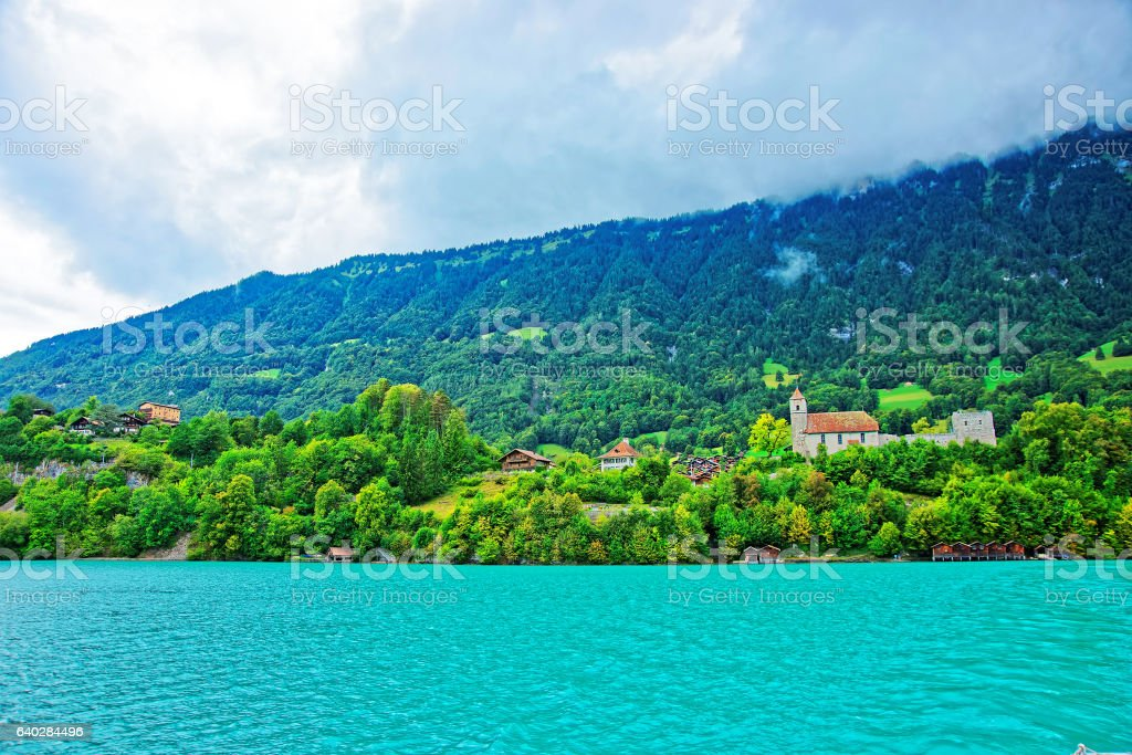 Church on Lake Brienz and Brienzer Rothorn mountain Bern Swiss stock photo