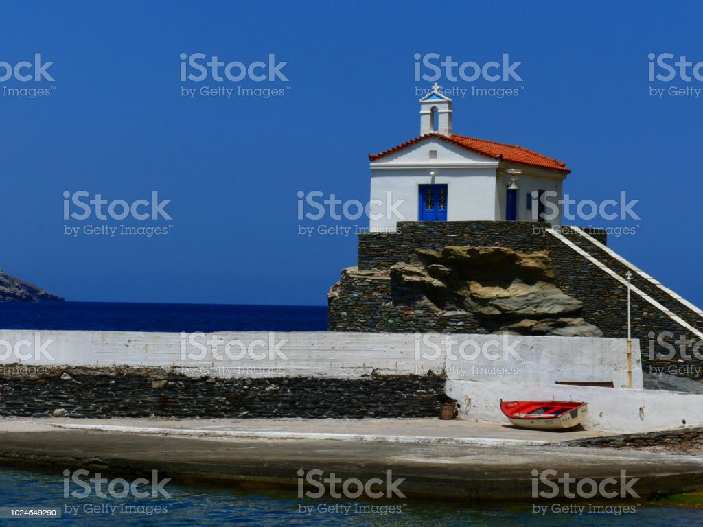 Church on the old port, Chora, Andros island, Greece stock photo