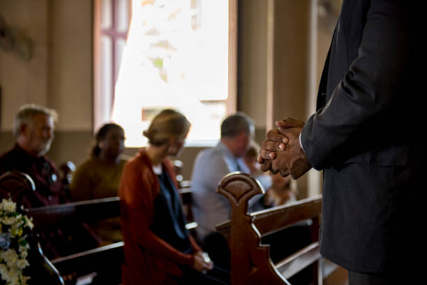 church people believe faith religious - church stock photos and pictures