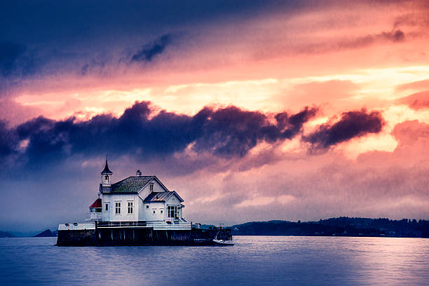 Church Perched on Stone in The Middle of Norwegian Fjord stock photo