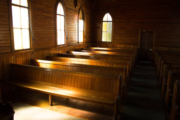 Church Pew Light playing on an antique wooden church pew pew stock pictures, royalty-free photos & images