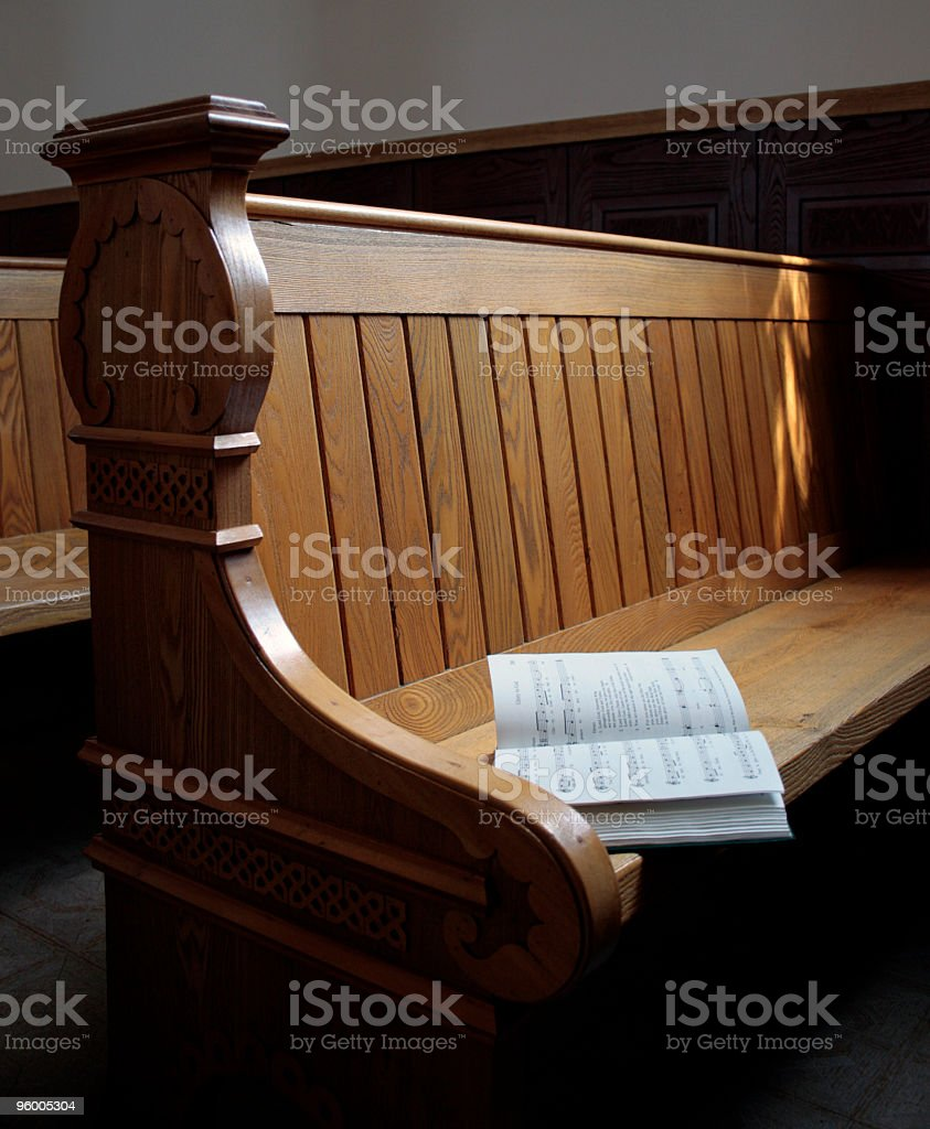 Church pew with open book royalty-free stock photo