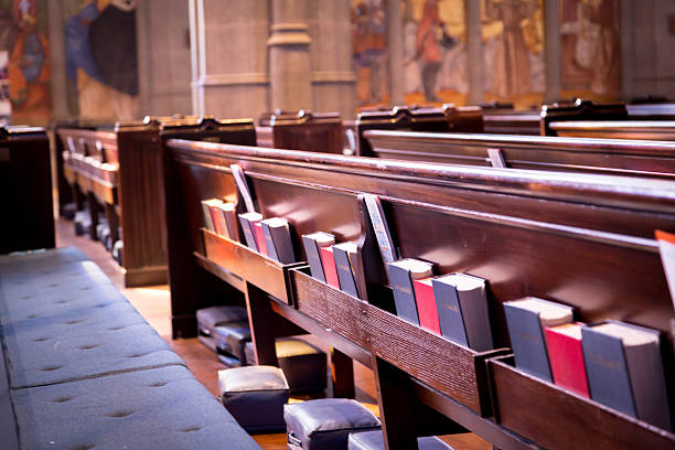 Church Pews Church Pews within a Church, containing cushions, Hymn book and Bible church stock pictures, royalty-free photos & images